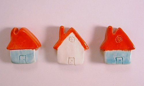 Light blue and white with red roofs