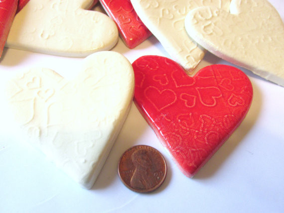 6 handmade embossed white and red heart tiles
