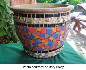 Mary's Mosaic flower pot grouted in cream and black grout.
