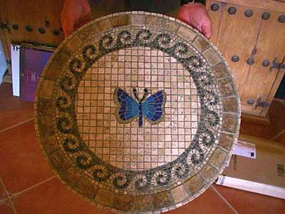 mosaic butterfly table made from travertine and glass tiles