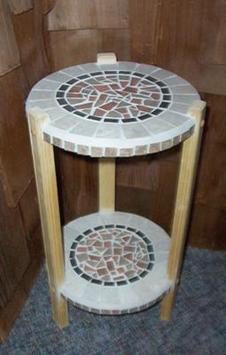 A mosaic round table for plants